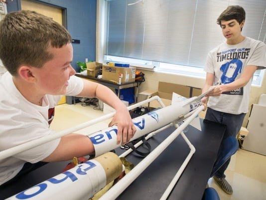 Kyle Abrahims, left, and Mike Abata with the rocket they prepared last year for the NASA Student Launch Initiative. NASA has eliminated the program for high school and middle school students, according to a Spring Grove teacher.