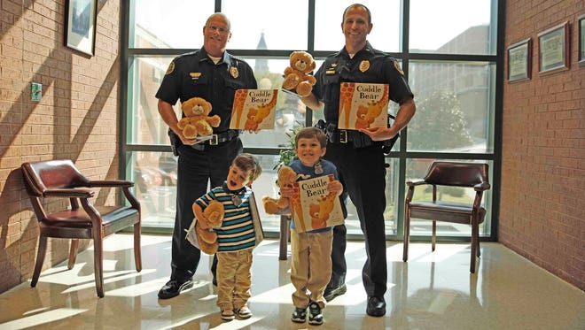 From the left, front, Silas Brown, Henry Brown; back, Deputy Chief Mike Parr, Lt. Chad Koyama.