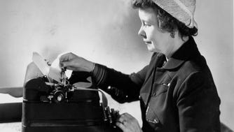 Ione Quinby Griggs crafts a reply to one of her readers in this undated photo