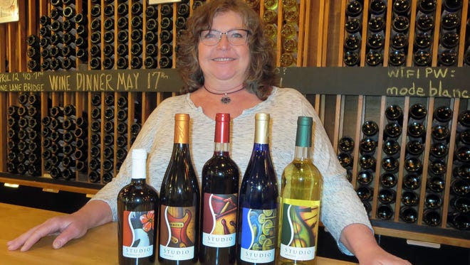 Kathy Jackson, the artistic half of Studio Winery, won a national award for her musically-themed wine labels.