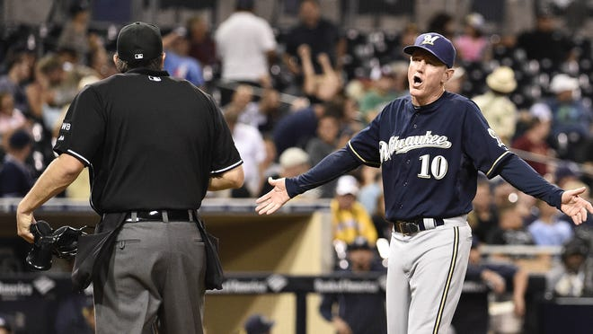 Brewers manager Ron Roenicke argues a call with umpire Mark Ripperger during the ninth inning of an Aug. 27 game against the San Diego Padres at Petco Park.