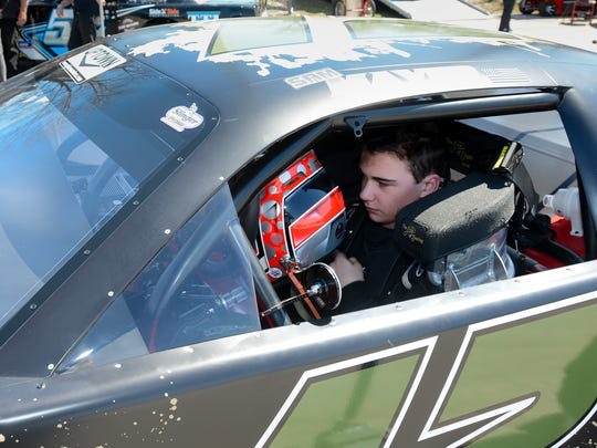 Sam Mayer sits in his car after a practice run at the Slinger Speedway season opener Sunday, April 29, 2018.