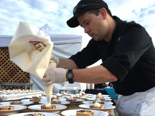Tony Sewell, the newly named executive chef for  Main Course California, pipes lemon curd cream atop berry crumble tortes during the Sunset on the Pier dinner benefiting efforts to repair and maintain the Ventura Pier.