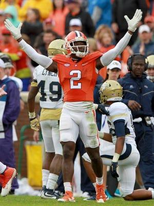 Clemson corner back Mackensie Alexander (2) celebrates after tackling a Georgia Tech ball carrier.