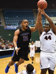 Raymond's Shardarrion Allen (12) shoots against Corinth during the MHSAA Boys 4A Championship Game held at The Coliseum in Jackson MS.(Photo/Bob Smith)