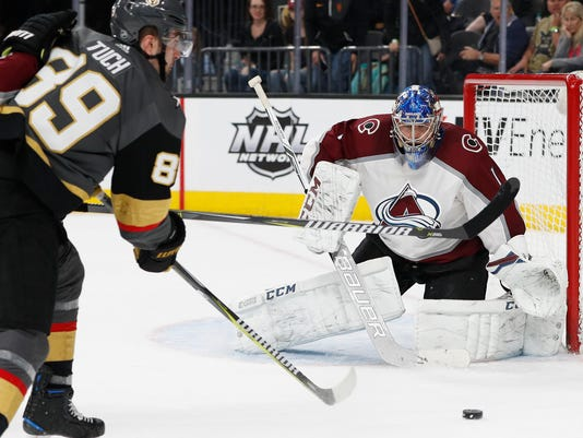 Vegas Golden Knights right wing Alex Tuch shoots on Colorado Avalanche goaltender Semyon Varlamov during the third period of an NHL hockey game, Monday, March 26, 2018, in Las Vegas. Vegas won 4-1. (AP Photo/John Locher)