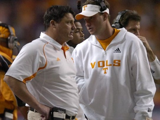 Former Tennessee coach Lane Kiffin talks with assistant