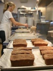 Heidi Dilger bakes banana bread in the kitchen of Recess restaurant.