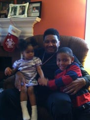 Jay Jefferson Cooke is pictured with his godchildren,