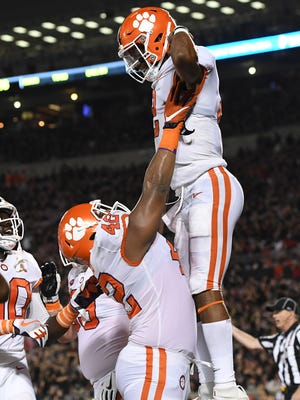 Clemson quarterback Kelly Bryant (2) celebrates with defensive lineman Christian Wilkins (42) after scoring against Louisville during the 3rd quarter on Saturday, September 16, 2017 at Louisville's Papa John's Cardinal Stadium.