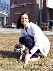 Dr. Tara Harris works with abused kids by day at Riley