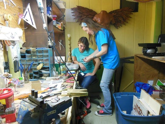 Lora Lee and her daughter Raven share a design in their