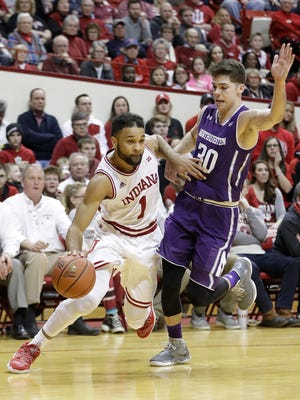 Indiana's James Blackmon Jr. is defended by Northwestern's Bryant McIntosh during the second half of an NCAA college basketball game Saturday, Feb. 25, 2017, in Bloomington, Ind. Indiana defeated Northwestern 63-62. (AP Photo/Darron Cummings)