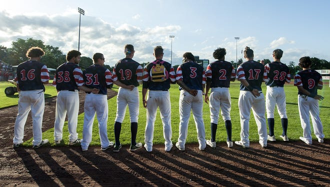The team lines up to listen to the National Anthem during the baseball game between the Williamsport Crosscutters and the Vermont Lake Monsters at Centennial Field on Thursday night July 14, 2016 in Burlington.