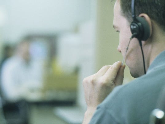 Phone salesman wearing headset in office
