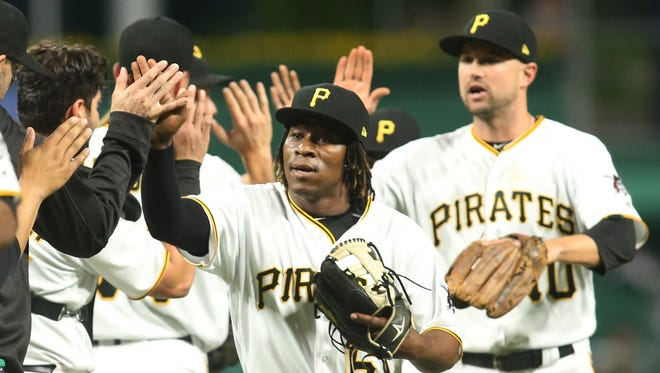 Pittsburgh Pirates second baseman Gift Ngoepe celebrates with teammates after defeating the Chicago Cubs at PNC Park.