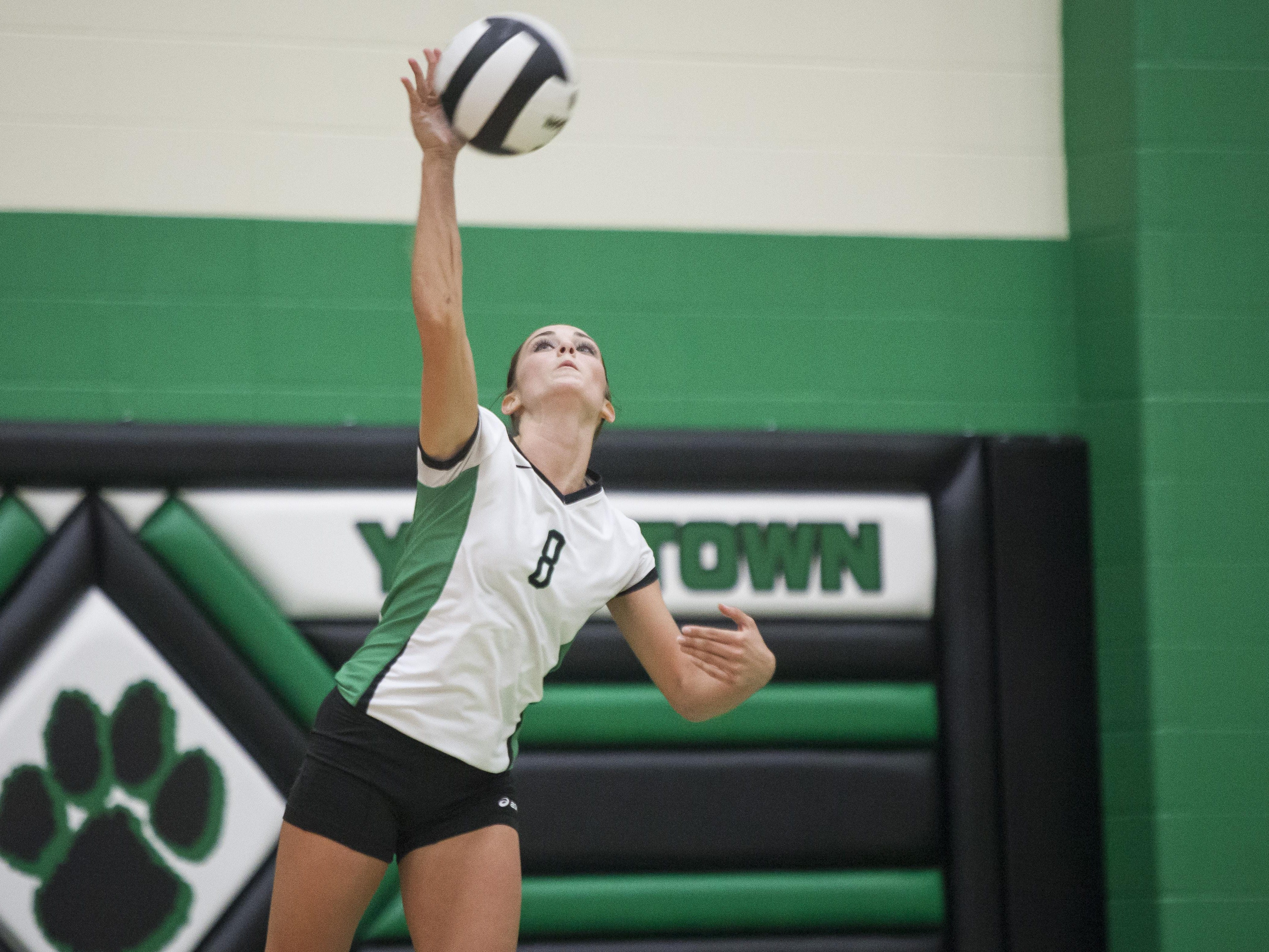 Yorktown's Jade York serves during Monday's home match against Wapahani. The Tigers swept the Raiders.