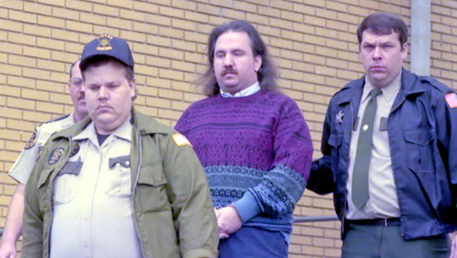 FILE - Sean Patrick Goble, center, is escorted from the Greene County Courthouse on Dec. 15, 1995, after being convicted of two counts of first-degree murder. He is escorted, at left, by then-Sgt. John Key of the Greene County Sheriff's Department and, at right, then-county Corrections Officer Charles Morelock. (Greenville Sun)