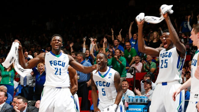 Florida Gulf Coast Eagles players react to winning the game over the Fairleigh Dickinson Knights during the First Four of the NCAA men's college basketball tournament at Dayton Arena. Florida Gulf Coast won 96-65.