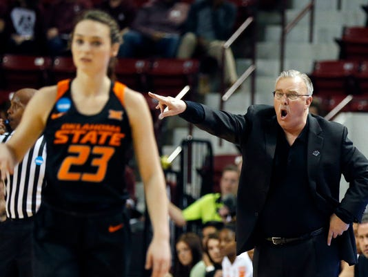 Oklahoma State head coach Jim Littell shouts instructions to guard Jaden Hobbs (23) during the second half of a first-round game against Syracuse in the NCAA women's college basketball tournament in Starkville, Miss., Saturday, March 17, 2018. Oklahoma State won 84-57. (AP Photo/Rogelio V. Solis)