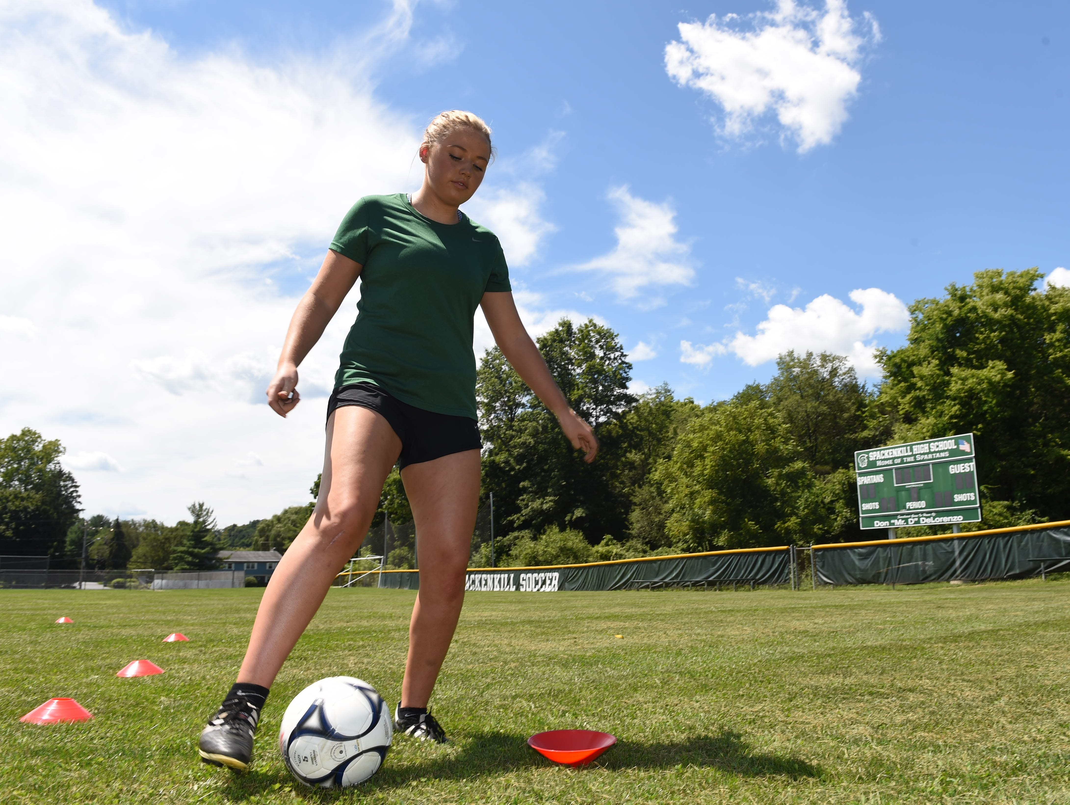 Eileen Fiore dribbles a soccer ball while demonstrating her workout routine at Spackenkill High School on Monday. Fiore tore her ACL during a playoff game against Dover High School on October 29, 2015.