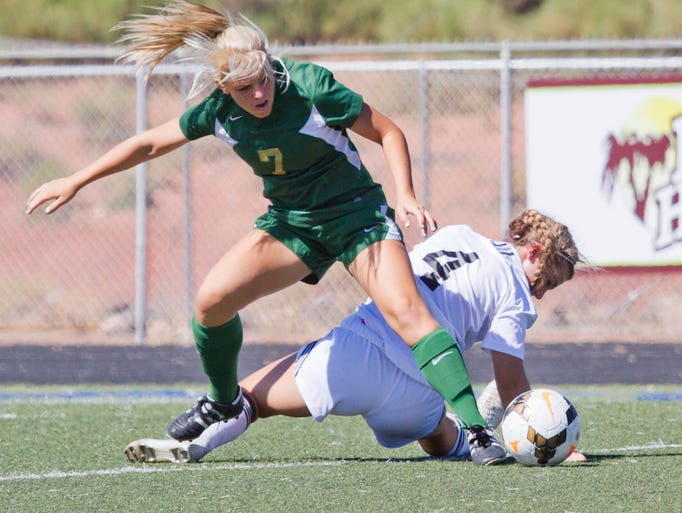 Mishayla Fausett, a Junior midfield from Snow Canyon, works to gain control of the ball during their match against Roy Saturday, August 16, 2014.