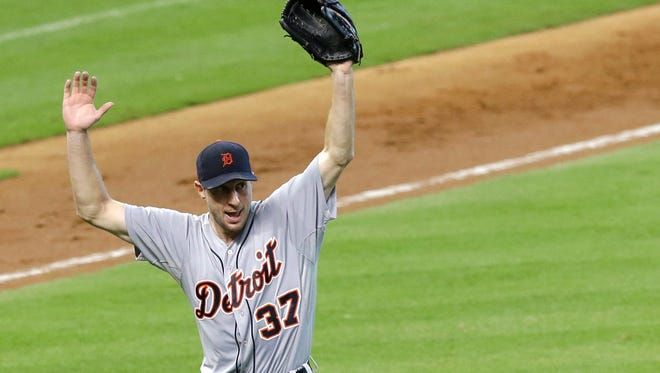 Detroit Tigers starting pitcher Max Scherzer (37) stays out of the way as catcher Bryan Holaday scoops up the ball on a Houston Astros' Jose Altuve ground-ball single in the fifth inning.