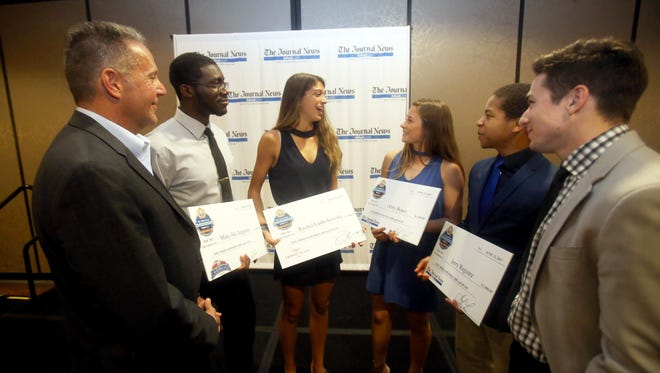 George Troyano, President and Publisher of The Journal News Media Group, left, and Journal News sports reporter Vincent Mercogliano, right, chat with the four scholarship recipients at the The Journal News/Lohud.com Rockland Scholar-Athlete dinner at the Crowne Plaza Hotel in Suffern June 13, 2017. Thirty five student athletes were honored, with four receiving $1,000 scholarships. The four scholarship winners were Marc-Ale Augustin of Spring Valley High School, Rachel Ludwikowski of Suffern High School, Abby Bosco of Suffern High School, and Jerry Registre of North Rockland High School.