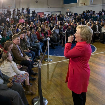 Democratic presidential candidate Hillary Clinton answers