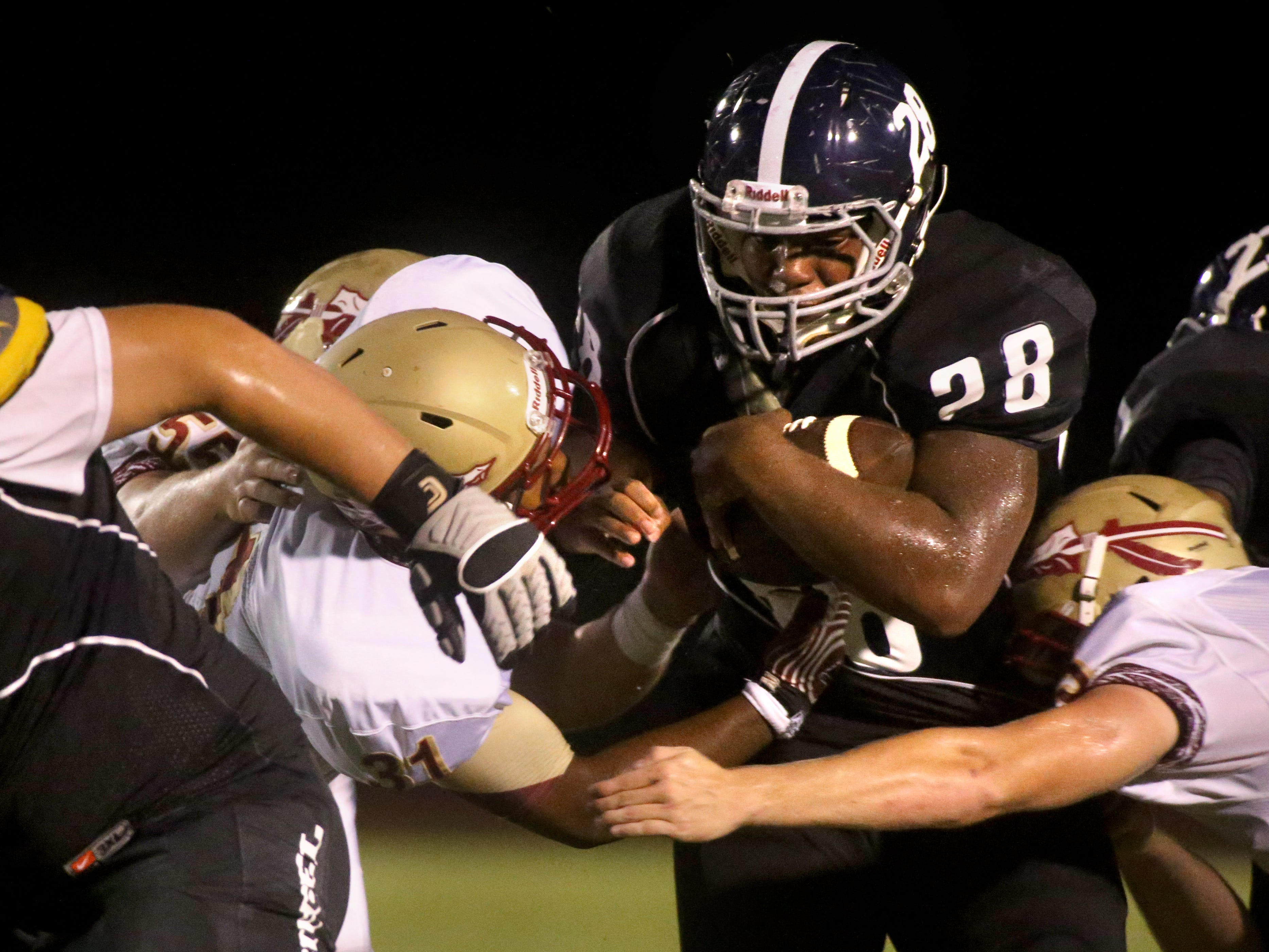Siegel's Andrew Knox runs the ball against Riverdale during the week zero game at Siegel, on Friday, August 22, 2014.