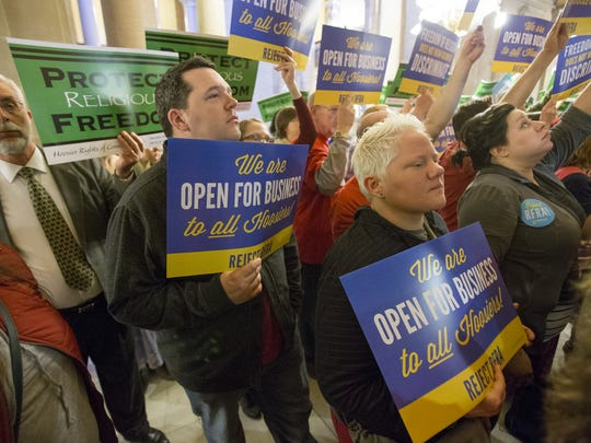 Community members on both sides, stand outside of the Indiana House during the meeting of an Indiana House committee to discuss the merits of Senate Bill 101, the Religious Freedom Bill, Indianapolis, Monday March 16, 2015.