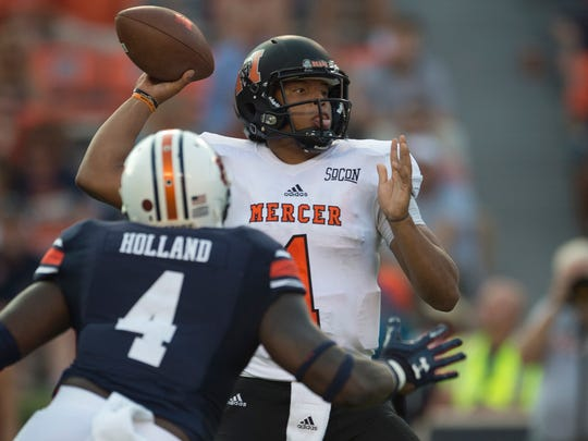 Mercer quarterback Kaelan Riley (1) throws a pass as Auburn linebacker Jeff Holland (4) rushes him during the NCAA Football game between Auburn and Mercer on Saturday, Sept. 16, 2017, in Auburn, Ala. Auburn defeated Mercer 24-10.
