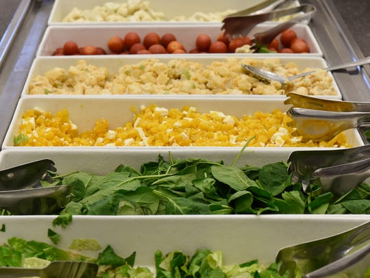 Fresh salad bar options, including a roasted pumpkin