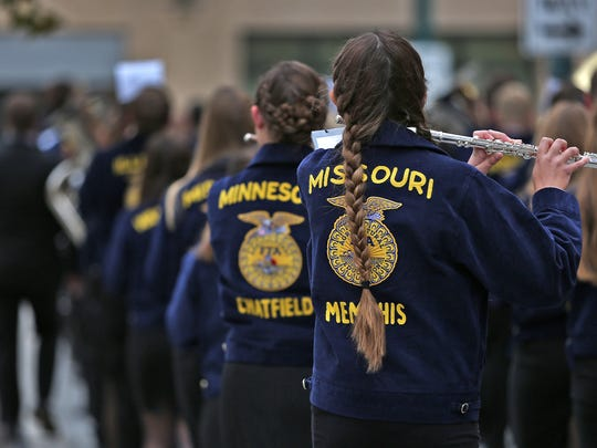 Members of the National FFA Band play during the FFA Grand March down FFA Way (Georgia St.) to Bankers Life Fieldhouse for the official opening of the 90th National FFA Convention, Wednesday, Oct. 25, 2017.