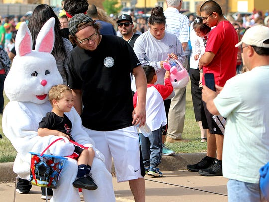 A child poses with the Easter bunny after the annual