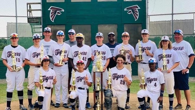 The age 14-and-younger Twinsburg Tigers travel baseball team won the open division of the Nations Baseball Ohio State Championships, which took place June 18 to 21 at Havens Baseball Complex in Jefferson. The Tigers earned a 10-2 victory over the Warren County Warthogs of Cincinnati in the championship game. This group of players reached the championship game of the Nations Baseball Ohio State Championshipsfor the third time. They also advanced in the age 10-and-younger and 13-and-younger divisions. Pictured are, front row, from left: A.J. Taneja, Nick Swerbinsky, Logan Miller and Jaden Dye; middle row: Matthew Sekerak, Stan Musbach, Kris Kimmel, Dawson Williams, Logan Mills, Luke Reasor, Kyke Keener and Logan Doskocil; and back row: assistant coach Ed Musbach, head coach Rich Swerbinsky and assistant coaches Tony Dye and Ryan Mills.