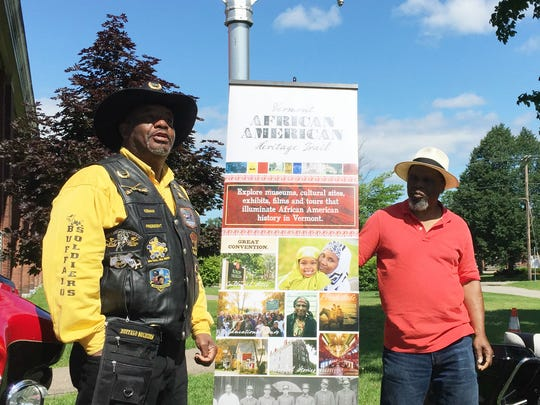 Richard Gardner, left, president of the Springfield, Massachusetts chapter of the Buffalo Soldiers Motorcycle Club, and Curtiss Reed, executive director of the Vermont Partnership for Fairness and Diversity, speak during a historic marker commemoration in Fort Ethan Allen in Colchester on Sunday, July 2, 2017.