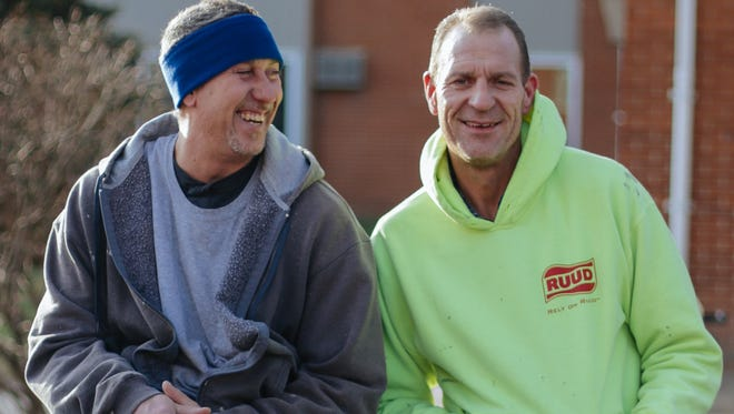 Thomas Highers, left, and his brother Raymond Highers at the Balmoral Arms Apartments in Sterling Heights, where Thomas is a maintenance man. Raymond works full-time for a heating and cooling service.