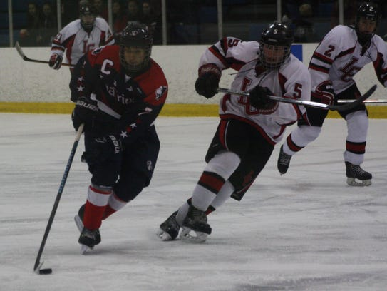 Franklin's Brendan Whitney steers the puck up the ice.