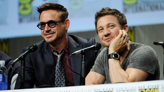 Actors Robert Downey Jr., left, and Jeremy Renner take part in the Marvel panel at Comic-Con International on Saturday, July 26, 2014, in San Diego. (Photo by Chris Pizzello/Invision/AP)