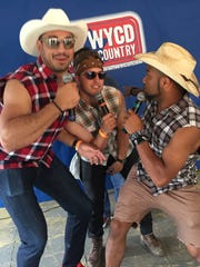 From left: Joe Fauria, Sam Martin and Golden Tate of the Detroit Lions pose backstage at the Downtown Hoedown in 2015.