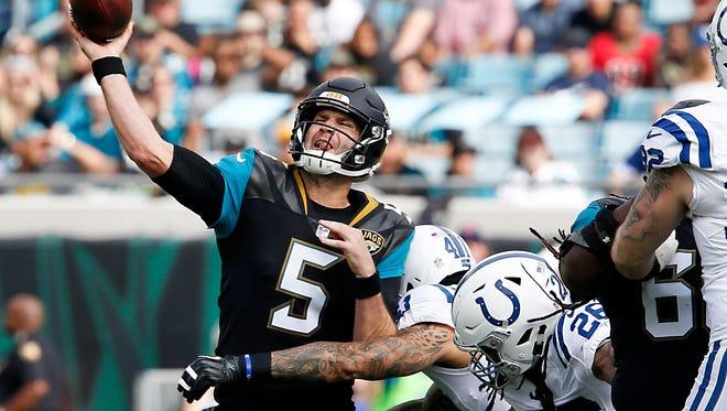 Dec 3, 2017; Jacksonville, FL, USA; Indianapolis Colts strong safety Matthias Farley (41) tackles Jacksonville Jaguars quarterback Blake Bortles (5) during the first quarter at EverBank Field.