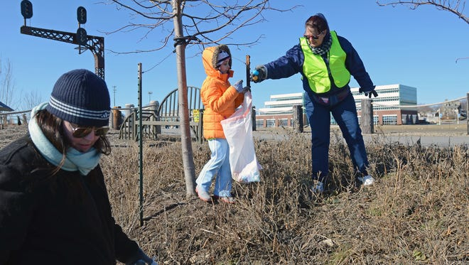 Volunteers find a pair of eggs during a River Walk trash clean up and Easter egg hunt.