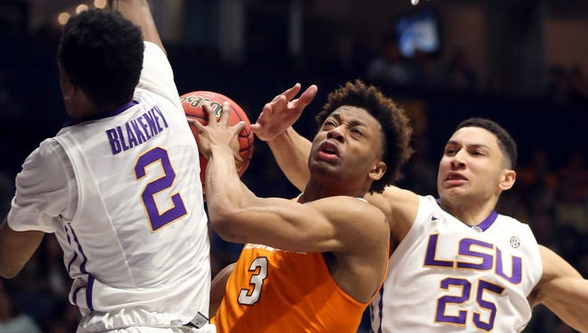 Tennessee's Robert Hubbs III (3) tries to drive against LSU's Ben Simmons (25) and Antonio Blakeney (2) during the second half of an NCAA college basketball game in the Southeastern Conference tournament in Nashville, Tenn., Friday.