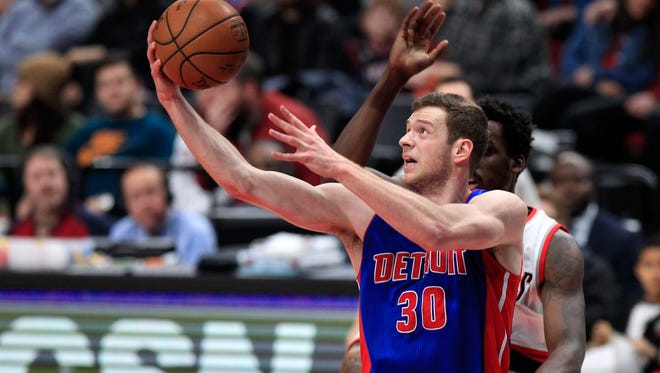 Pistons forward Jon Leuer shoots as Trail Blazers forward Al-Farouq Aminu defends during the first half Jan. 8, 2017 in Portland, Ore.