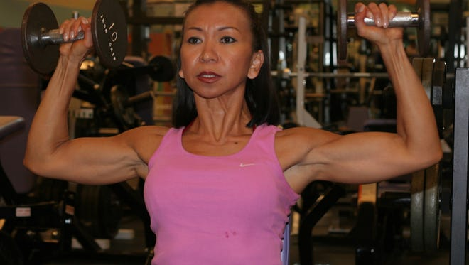 In this file photo, Florencia Burke trains for  2007 Guam National Bodybuilding and Figure Championships.