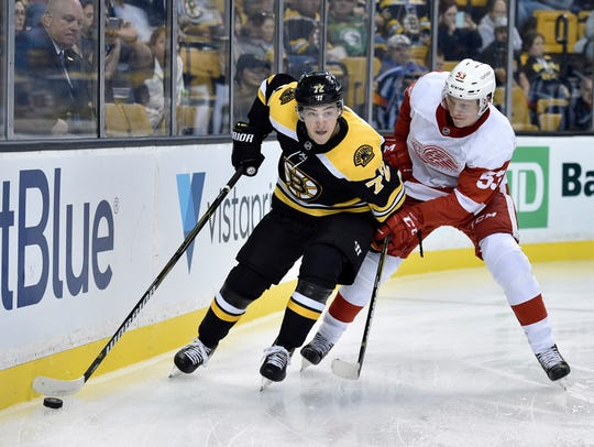 Bruins center Frank Vatrano controls the puck against Red Wings defenseman Dennis Cholowski during the Wings' 4-2 exhibition loss to the Bruins on Sept. 19, 2017.