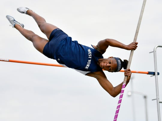 Trinity Thomas competes in the pole vault trials Friday,