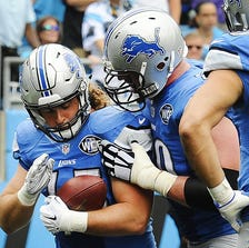 Jed Collins cradles the football after scoring against the Panthers last Sunday.