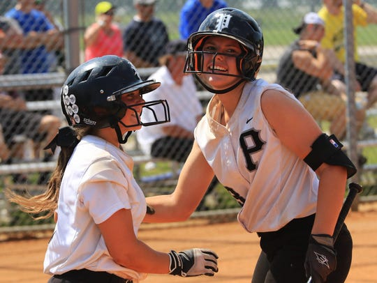 Plymouth's Jessica Tucci (left) is congratulated by
